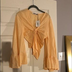 Tie front top with bell sleeves